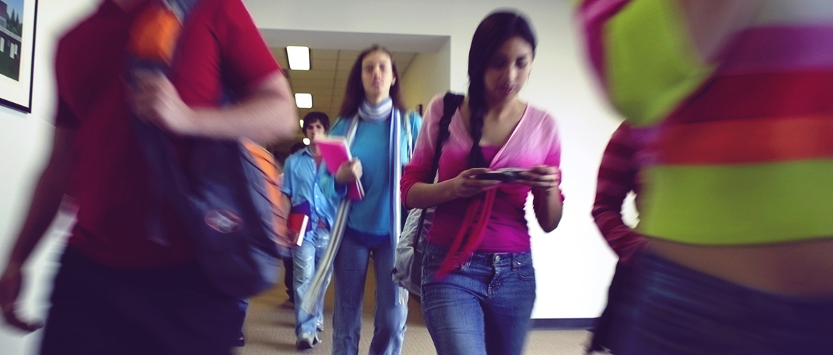 Diverse group of students walking in a hallway
